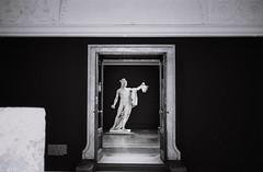 Entrance (ALGHIME) Tags: bnw blackandwhite bw monochrome entrance statue door grainy film analogue leica m6