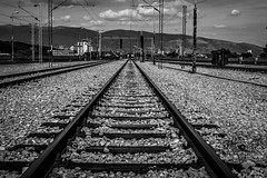 To Infinity (Andrej_Filipovski) Tags: skopje macedonia railway railways railroad rail rails dark black white contrast strong infinity filipovski rock rocks sky cloud clouds road monochrome monochromatic line lines iron steel cable cables focus