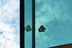 High in the sky (Maerten Prins) Tags: netherlands nederland nijmegen bastei upshot child girl glass balcony reflection sky clouds lines abstract green blue