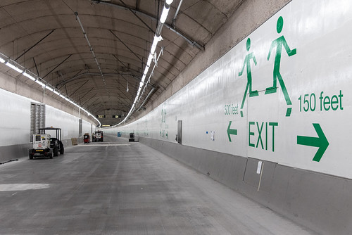 """""""Running men"""" point to emergency exits inside the SR 99 tunnel"""