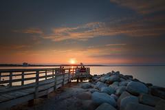 Relaxation (PhotoChampions) Tags: sunset sonnenuntergang niendorf ostsee balticsea seascape landscape landschaft küstenlandschaft people rocks steine sun sonne sky himmel mole