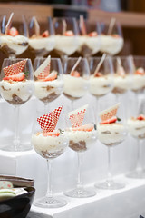Tiramisu. Rolls of tiramisu with soft focus on the front tiramisu's white chocolate in the champaign glass. (enchanted.fairy) Tags: appetizer banquet brown buffet calorie candy catering celebration chocolate close cocktail cream cuisine decoration delicious dessert dinner dish eat elegant event food fountain fresh fruit glass gourmet health healthy holiday isolated liquid luxury meal orange party reception red restaurant service shiny strawberry sweet table tasty up variety wedding white yummy