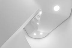 White staircase (Maerten Prins) Tags: germany duitsland deutschland hamburg stair stairs stairwell staircase steckelhörn soft railing white architecture indoor line lines curve curves triangle geometry geometric lamp light highkey abstract