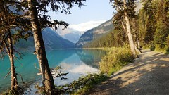 Early morning on the Lake Louise Lakeshore Trail (lhboudreau) Tags: lakelouise lakeshore trail lake water mountvictoria victoria glacier victoriaglacier mirror reflection tree trees path outdoor outdoors lakelouiselakeshoretrail shore mountain mountains canadianrockies rockymountains shadow shadows morning hike canada alberta landscape wood