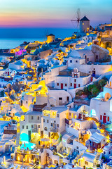 Travel Concepts. Skyline of Oia Town with Traditional White Architecture and Iconic Windmills in Village of Santorini in Greece.World Famous Resort. (DmitryMorgan) Tags: landscape aegean architecture aurora bluehour building caldera church cityscape destination dusk europe european famous greece greek hellenic historic holiday island iya landmark mediterranean mountain oia oya panoramic picturesque resort rock romantic santorini scenery sky slope summer summit sunlight sunny thera tourism town traditional traveling twilight view village volcano windmill