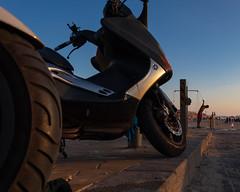 Hanging out (Ivona & Eli) Tags: perspective summer light sunset bike beach man street