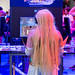 Female cosplayer playing Dragon Quest XI: Echoes of an Elusive Age at Gamescom 2018