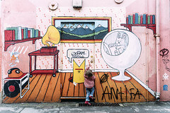Imagination is a doorway. (markfly1) Tags: child children kids kid little girl all colour color red green blue yellow white pink cyan orange brown beige cartoon graffitti street art comic view key doorway open up please imagination play playtime shapes circles lines wall image candid photo nikon d750 35mm manual lens