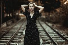 Eszter (Vagelis Pikoulas) Tags: girl woman portrait athens greece attiki attica europe september autumn 2018 train raliway bokeh canon 6d hungarian symmetry art sigma 85mm f14