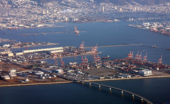 Port of Kobe, Japan (Jaws300) Tags: flying scenery from above kobe airport japan mountain mountains city bay osaka osakabay runway ramp apron atc tower vmc vfr morning approaching landing airbus boat boats ship ships tug tugs workboat workboats vessel vessels maritime high rise buildings highrise skyscraper building downtown sky water aerial landscape sea airplane flyingscenery fromabove canon5d crane cranes containerships container containers freight cargo portofkobe port terminal hall 神戸ポートターミナルホール kobeport warehouse (株)上組 神戸総合物流センター cfs輸出チーム