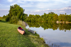 Still Water Runs Deep (SteveFrazierPhotography.com) Tags: pond lake water boats canoes reflection reeds shore shoreline grass trees clouds sky beautiful scene landscape waterscape shadows sunlight country countryside afternoon paddles mcdonough county illinois il