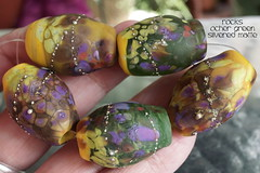 Rocks Ocher Green Silvered Matte (Laura Blanck Openstudio) Tags: openstudio openstudiobeads glass handmade lampwork murano beads set made usa fine arts jewelry art artist artisan whimsical funky odd colorful multicolor abstract asymmetric earthy organic bohemian boho matte opaque frosted gypsy etched glow glowing nuggets rocks pebbles stones sterling silver silvered yellow ocher suede mustard lilac lavender grape violet purple eggplant plum green bottle pine mermaid pistachio brown honey caramel burnt umber amber coral apple chartreuse kiwi