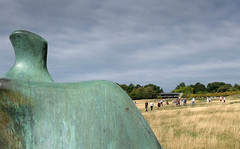 Sunday visitors approaching one of Henry Moore's reclining female figures (Allan Rostron) Tags: art yorkshiresculpturepark wakefield henrymoore recliningfigure