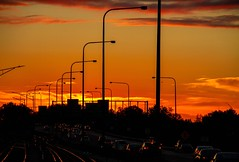Industrial Sunset (Karen_Chappell) Tags: sunset orange black silhouette travel illinois chicago lines clouds sky weather evening lights cars railroad tracks highway freeway commute transportation usa street road
