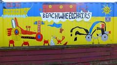 Autumn Afternoon at Portobello 024 (byronv2) Tags: sunny sunlight sunshine autumn portobello edinburgh edimbourg scotland coast coastal sea northsea firthofforth forth rnbforth river riverforth beach portobellobeach colour colourful art beachwheelchairs shippingcontainer yellow blue red sign