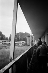 Abandoned holiday chalets (esmeelily) Tags: 35mm film analog lomo lomography grain ilford black white is dead urbex derelict abandoned building olympus trip af 50