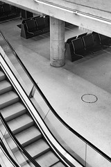 ZRH Monochrome Escalator (Packing-Light) Tags: 120 6x45 mamiya6451000s analog film mediumformat kodak portra160 negative c41 reversal switzerland airport swiss zurich concourse terminal travel architecture zrh stairs escalator lines