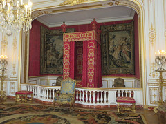 Chambord. Royal bedroom. (Traveling with Simone) Tags: bedroom chambre lit rouge lustre candelabra bed chairs chaises fauteuil wall tapestry colors couleurs