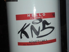 907 (en-ri) Tags: kns nero tag firenze wall muro graffiti writing adesivo sticker ninotchka bianco rosso
