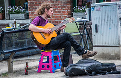 2018 - Belgium - Gent - Street People - 6 of 6 (Ted's photos - For Me & You) Tags: 2018 belgium cropped ghent nikon nikond750 nikonfx tedmcgrath tedsphotos vignetting onebottle one male man musician entertainer guitar guitarplayer 6stringguitar seating seated playing guitarcase bench streetscene street