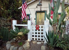 """Semper Fi"" (Bennilover) Tags: home humble cactus old flag insignia marines marine capistrano pride country patriotic usmarinecorp flags fence cottage semperfi"
