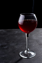 Red wine glass with long shadows on stone table. With copy space for your text (lyule4ik) Tags: wine glass red background black alcohol beverage cabernet drink winery bar closeup copy liquid luxury old table dark copyspace dry food marble nobody redwine slate space stone vintage bottle celebration elegance gourmet pour wooden bordeaux event merlot motion pouring restaurant splash wineglass alcoholic blank board booze brand cellar closed cork