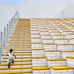 Onwards and upwards (Arni J.M.) Tags: architecture building onwardsandupwards glass wall bjarneingelsgroup ralphappelbaunassociates steps levels lines yellow buddingmountaineer geometry bricks legohouse billund denmark