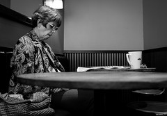 2018_241 (Chilanga Cement) Tags: fuji fujix100f fujifilm 100f acros bw blackandwhite monochrome lady coffee candid table woman reading
