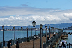 Bay Line (Francoise100) Tags: california lamppost streetlamp jetty clouds cali water waterfront