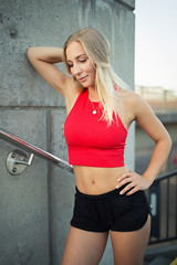 sporty girl (Michael Kremsler) Tags: model girl portrait fashion hotpants bellytop blond longhair streetfashion bokeh availablelight shooting city public stairs evening summer