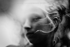 Wisps. I just had to capture these. They looked so beautiful blowing across her face... (privizzinis passion photography) Tags: blackandwhite portrait hair freelensed girl child children childhood wind outdoors people light backlight