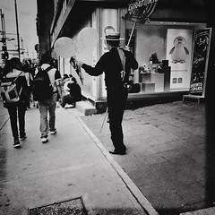 Back. Balloons (TheKinkyKid) Tags: weekend friday midday summer hot sunny candid stranger hat people black shirt pants back gentleman men mexicocity mexico iphone hipstamatic johns kitsune67 makebeautiful hipstaoftheday photooftheday iphoneonly blackandwhite bw monochromatic photojournalism streetphotography streetstyle sunrise beautiful fun happy nomnomnom