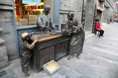 Qianmen Merchant (peterkelly) Tags: digital canon 6d gadventures transmongolianadventure china asia beijing qianmen sculpture statue art installation man street merchant vendor chair child rub polished