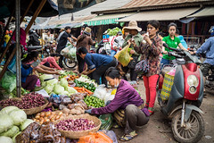 2015 Siem Reap (paulcore8118) Tags: market siem reap cambodia vegetables street morning shopping motorbike cabbage onion shallots carrots raddish lime capsicum cucumbers chilli bananas