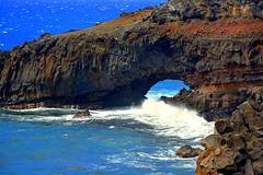 A Maui Arch (Kirt Edblom) Tags: maui mauihawaii hawaii highway31 southside water waves waterscape arch lava lavaflows blue bluesky bluewater hanahighway wife gaylene milf brown rocks rock rockformation ocean pacific pacificocean scenic serene landscape seascape kirt kirtedblom edblom easyhdr hdr nikon nikond7100 nikkor18140mmf3556 cliff coast