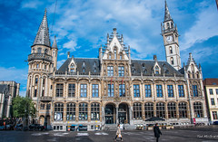 2018 - Belgium - Gent - Old Post Office (Ted's photos - For Me & You) Tags: 2018 belgium cropped ghent nikon nikond750 nikonfx tedmcgrath tedsphotos vignetting ghentbelgium townsquare townsquareghent sintbaafsplein sintbaafspleinghent umbrella people peopleandpaths pathsandpeople turrets clock clocktower arches