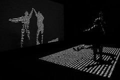 Dance of words and letters (Mikhail Korolkov) Tags: street streetphotography silhouettes shadows backlight backlit letters words wall projection