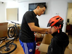 free helmets and fitting (citymaus) Tags: fast freddie foundation ambassador housing affordable kids children helmet helmets bikes fitting givaway giveaway bike eastbay emeryville oakland specialized bicycle bicycles youth