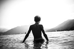 Towards the last sun (PaxaMik) Tags: sun summertime annecy plagedesmarquisats black blackandwhitephotos baignade swimmer lac lacdannecy back dos light lumière été frenchlakes