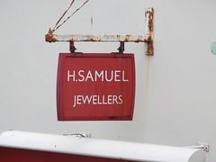 H Samuel Sign, Market Jew Street, Penzance 16 August 2018 (Cold War Warrior) Tags: sign samuel rust penzance advertising