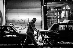 Night Walk (seleemdarwish) Tags: street people night blackandwhite bw man kid light lights art dark simple nikon alexandria egypt alex explore