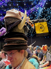 A Man of Many Hats (Coyoty) Tags: anthrocon2016 davidllawrenceconventioncenter pittsburgh pennsylvania pa furry convention hats coyote stack closing ceremonites fandom fun furryfandom colors viking hat vikinghat fox toy horn flag audience people brim pun humor wordplay costumes brown purple yellow blue