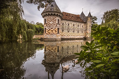 """viewed from the left of the drawbridge, the lovely Château de Saint Germain de Livet, fine art colour, Pays d'Auge, Normandy, France (grumpybaldprof) Tags: """"châteaudesaintgermaindelivet"""" """"paysd'auge"""" normandy normandie france medieval renaissance artists collombage """"halftimber"""" moat castle chateau liseiux """"greenstones"""" copper slate beautiful history monument museum """"eugènedelacroix"""" calvados """"léonriesener"""" checked charming lovely water reflection drawbridge towers dragons mood atmosphere """"fineart"""" ethereal striking artistic interpretation impressionist stylistic style colours """"wideangle"""" ultrawide canon 70d """"canon70d"""" sigma 1020 1020mm f456 """"sigma1020mmf456dchsm"""" swans swimming reflections"""