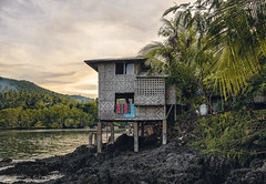 Wooden house on Balut island. (Matthias Dengler || www.snapshopped.com) Tags: matthias dengler snapshopped photography balut island philippines filipino wooden hut house cabin nature sunset golden hour adventure travel explore create discover remote paradise mindanao mountain mountains plants palms sun clouds