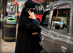 `2387 (roll the dice) Tags: london westminster fashion urban england uk art classic canon tourism tourists mad sad fun funny surreal burka burqa niqab muslim veiled culture eyes rubbish lookalike twins fingers mobile phone talk taxi portrait strangers candid unaware unknown traffic oxfordstreet lights westend pretty sexy girl gap banned religion reaction smile bargain people dark