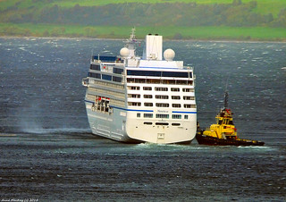 Scotland Greenock the cruise ship Nautica needing the help of three tugs during the storm Ali after snapping her mooring lines 19 September 2018 by Anne MacKay