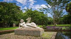 Reformed Eden (dayman1776) Tags: brookgreen gardens south carolina usa america sculptures sculpture statue escultura skulptur nude woman girl figurative art museum garden blue sky animal reclining