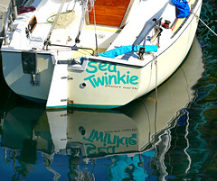 Sea Twinkie (Colorado Sands on autumn break) Tags: boat sailboat stern reflection redondobeach california usa sandraleidholdt planetearth seatwinkie text water twinkie