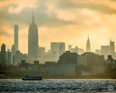 Summer Morning Commute (brianloganphoto) Tags: ferry waterfront manhattan northamerica regions newyork hudsonriver empirestatebuilding sunrise water nyc transportation buildings sky skyline unitedstates newyorkcity marine chrysletbuilding weehawken newjersey us