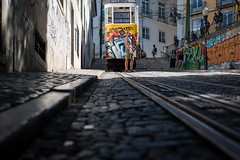 on the streets of Lisbon (literally) / the tram on the hill (Özgür Gürgey) Tags: 2018 50mm d750 lisboa lisbon nikon portugal lowangle people rails street tram